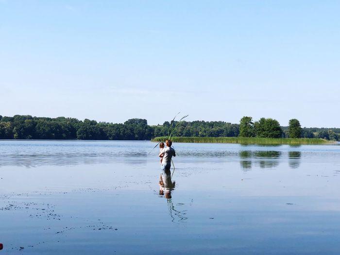 Full length of woman on lake against sky
