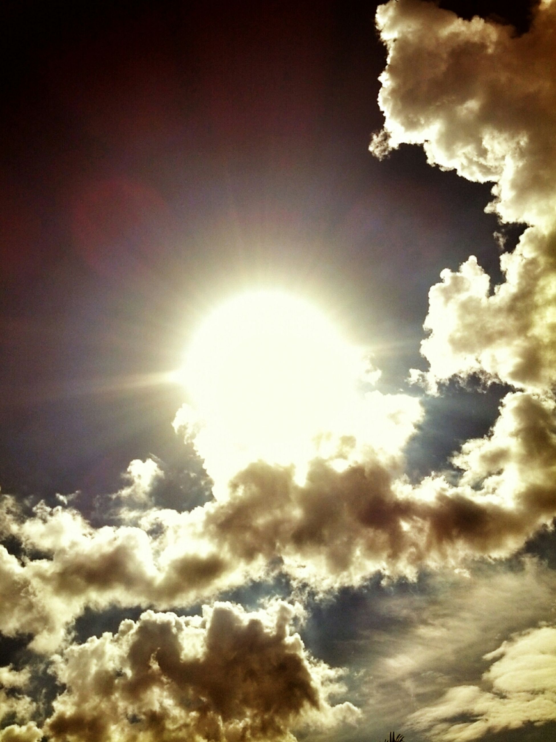 sky, sun, cloud - sky, low angle view, sunbeam, sky only, beauty in nature, cloudy, scenics, tranquility, sunlight, nature, cloudscape, cloud, tranquil scene, idyllic, lens flare, bright, weather, backgrounds