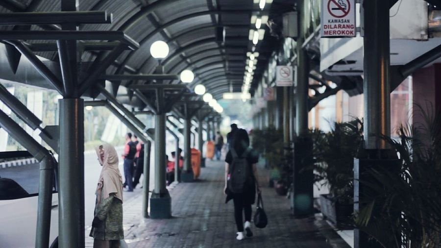 People walking in corridor of city