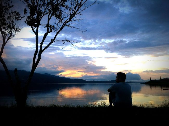Sunset In The Lake Danau Kembar Alahan Panjang Sunset Solok Sumatera Barat My Life My Adventure Danau Di Atas Danau Di Bawah Silhouette Rear View Sunset Reflection Adults Only One Person Water Shades Of Winter EyeEmNewHere Business Stories