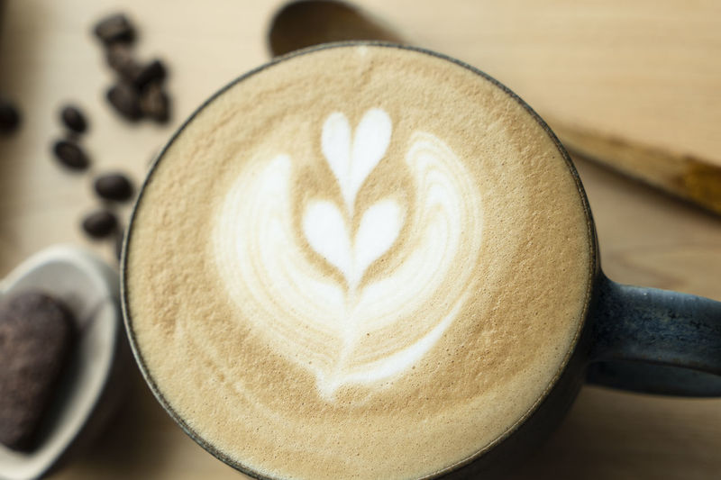 top view over coffee latte art foam milk Frothy Drink Still Life Indoors  Cappuccino Creativity Hot Drink Refreshment Froth Art Coffee Cup Cup Close-up Mug Drink Coffee - Drink Love Heart Shape