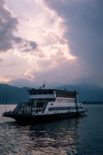 Ferry Tourist Attraction  Beauty In Nature Cloud - Sky Day Departure Ferry Lake Landscape Leaving Mode Of Transport Mountain Nature Nautical Vessel No People Outdoors Sailing Scenics Sea Sky Sunset Tourism Transportation Water Waterfront