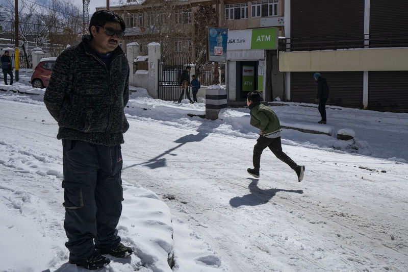 Children playing in snow during winter