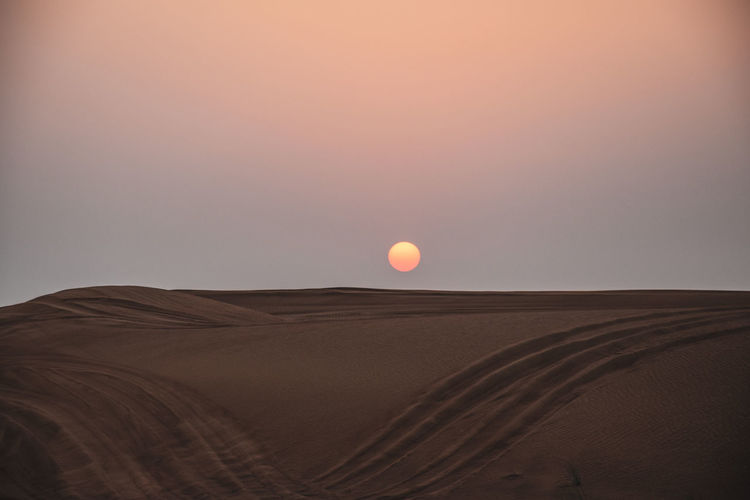 dubai desert Sky Scenics - Nature Beauty In Nature Desert Environment Tranquil Scene Landscape Land Sunset Tranquility Arid Climate Non-urban Scene Climate Nature Sand Dune Sand No People Sun Remote Horizon Outdoors Atmospheric Dubai Desert