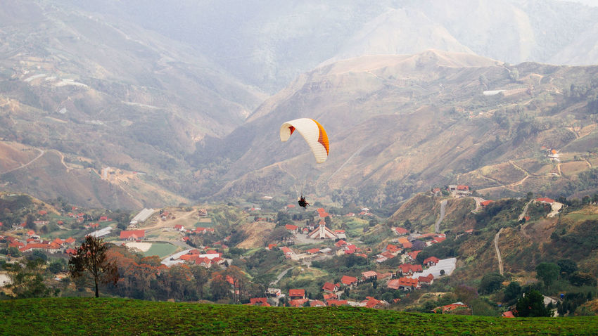 Vuelo en Parapente Adventure Beauty In Nature Day Environment Flying Go Higher Idyllic Land Landscape Mid-air Mountain Mountain Range Nature No People Non-urban Scene Outdoors Parachute Plant Scenics - Nature Tranquil Scene Tranquility Travel Destinations #FREIHEITBERLIN