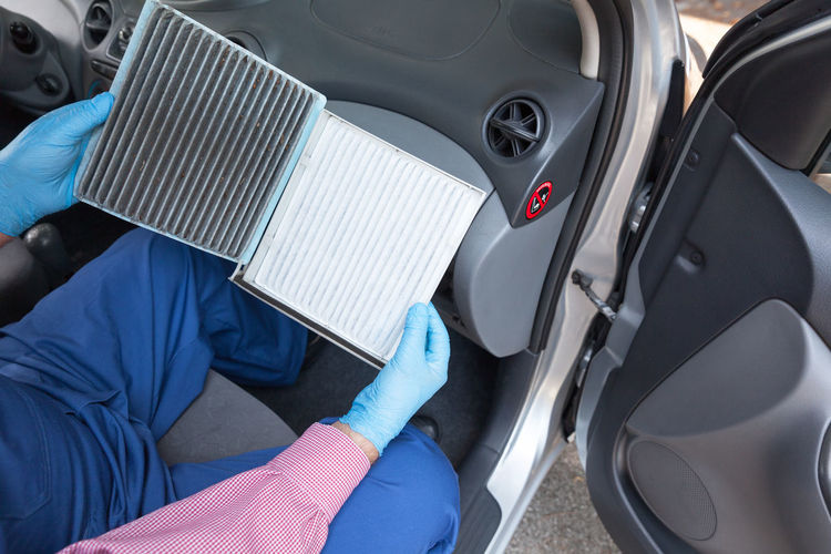 Auto mechanic holding clean and dirty car cabin air filter . Replacing old pollen filter of a car Car Motor Vehicle Land Vehicle Transportation Mode Of Transportation Protection Vehicle Interior Car Interior Air Filter Car Filter Filter Pollen Filtration Air Dust Conditioner Hygiene Maintainance Auto Mechanic Car Parts Service Replacing