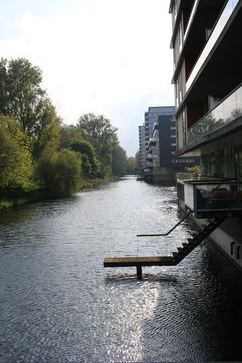 River in city against sky