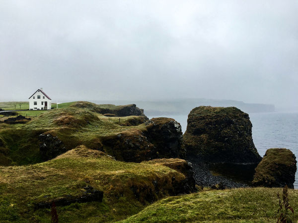 Arnastarpi view - Iceland Arnastapi Beauty In Nature Calm Cliff Coastline Day Horizon Over Water House Iceland Nature Non-urban Scene Ocean Outdoors Remote Scenics Sea Shore Sky Solitude Tourism Tranquil Scene Tranquility Vacations Water