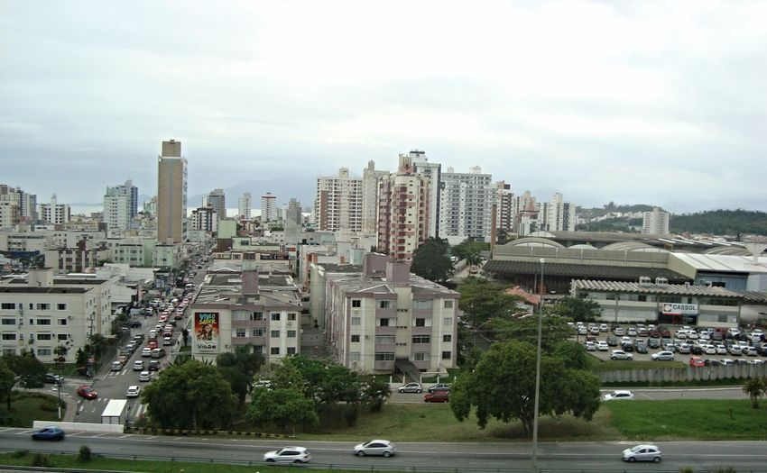 Sao Jose SC - Beira Mar Car Architecture Cityscape Building Exterior City Skyscraper Cloud - Sky Urban Skyline Built Structure Transportation Road Outdoors No People Sky Tree Day Apartment Mobility In Mega Cities