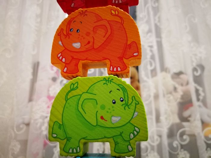 Elephant Wooden Toys Multi Colored Kids Childhood Cheerful Positive Orange Color Green Color No People Anthropomorphic Face Close-up Indoors  Representing