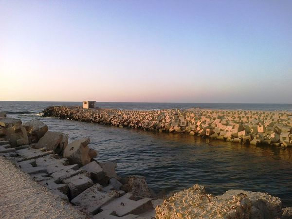 Alexandria Egypt Architecture Beach Beauty In Nature Beauty In Nature Clear Sky Coast Coastline Day Dusk In The City Groyne Horizon Over Water Mediterranean  Nature No People Outdoors Road Rocks And Water Scenics Sea Sky Tranquil Scene Tranquility Water