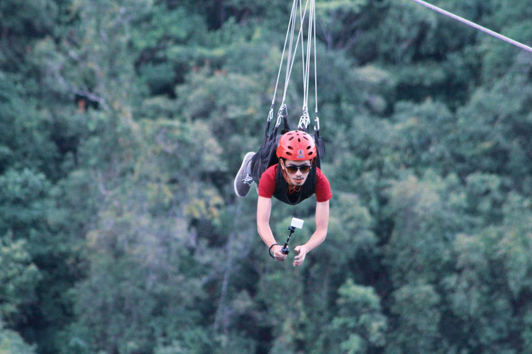 fly high Zipline Ziplining Zipline Adventure EyeEm Selects The Great Outdoors - 2018 EyeEm Awards EyeEm Best Shots Adventure EyeEmNewHere Tree Rope Swing Full Length Hanging Forest Motion Mid-air Swing Childhood Headwear The Traveler - 2018 EyeEm Awards
