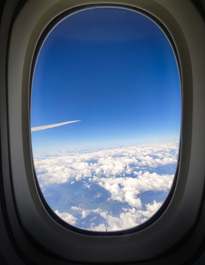 Scenic view of sky seen through airplane window