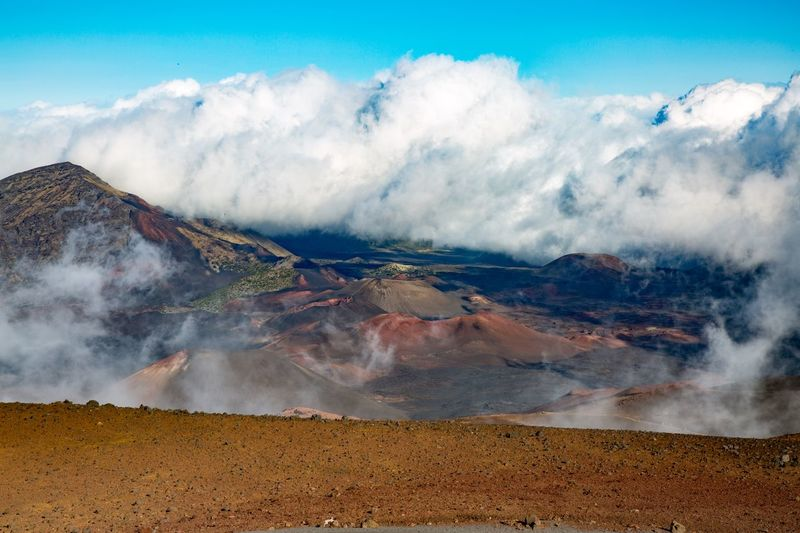 Scenic view of volcanic landscape against sky