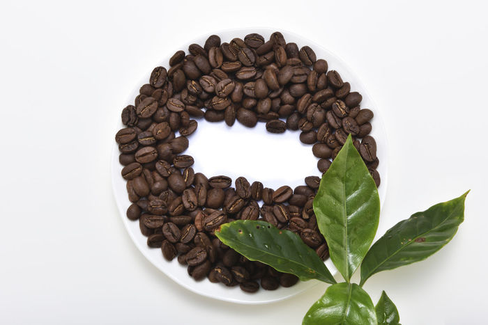 Baked coffee beans Coffee Coffee Fruit Pure Bake Close-up Coffee Bean Coffee Beans Day Directly Above Drink Food Food And Drink Fragrant Freshness Healthy Eating Heart Shape Indoors  Leaf No People Roasted Coffee Bean Scented Studio Shot White Background White Background Indoors White Background,