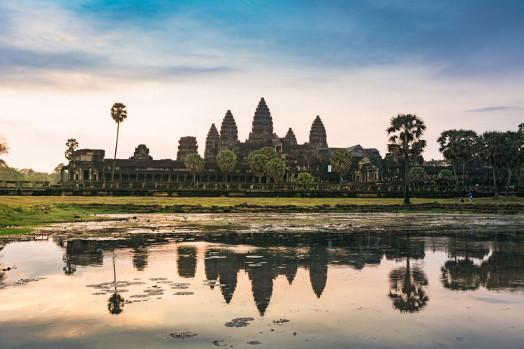 Sunrise in angkor wat, a temple complex in cambodia and the largest religious monument in the world