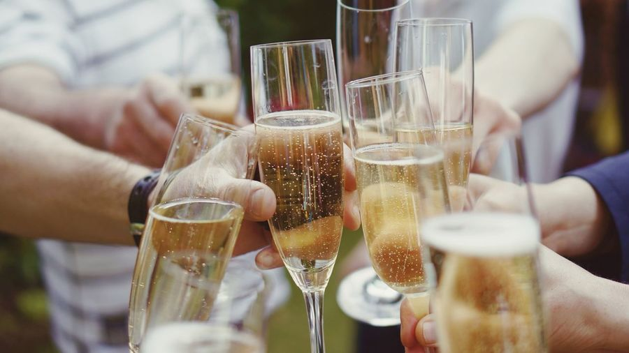 People Toasting With Champagne Flute