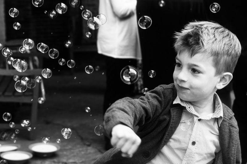 Portrait of boy looking at bubbles