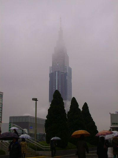 Architecture Building Exterior Built Structure Day Fog J Japan Real People Sky Skyscraper Travel Destinations Tree