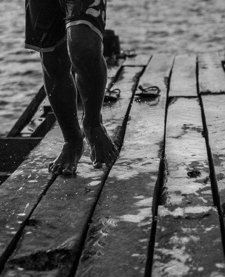 Run for fun. Bnw Bnw_friday_eyeemchallenge Monochrome Bnw_collection #monochrome Low Section Standing Human Leg Shadow Men Sunlight FootPrint Trousers Boardwalk Pavement Human Feet Hood