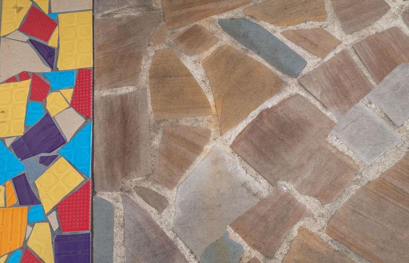 High angle view of multi colored pattern on tiled floor