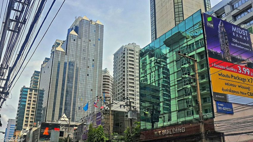 Reflexions Architecture Bangkok Building Exterior Built Structure City City Life Cityscape Low Angle View Modern Office Building Outdoors Reflexions Skyscraper Tall - High Thailand Travel Destinations