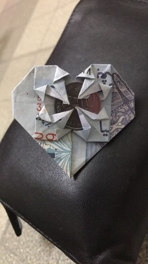 Love in Ringgit Paper Crumpled Crumpled Paper No People Indoors  Brown Paper Close-up Day Origami Ringgit Money Love Heart