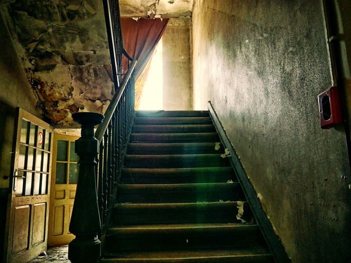 Steps Steps And Staircases Staircase Railing Indoors  Built Structure Stairs Architecture Day No People Stairway Abandoned Buildings Urbexphotography Abandoned Architecture Bad Condition Damaged Indoors  The Look Forward Doors Antique Urbex Abandoned Places Vintage Photography