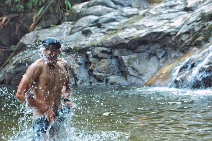 EyeEmNewHere Real People Outdoors Waterfall Water Wet Motion Nature Shirtless Adult Outdoor People EyeEmNewHere