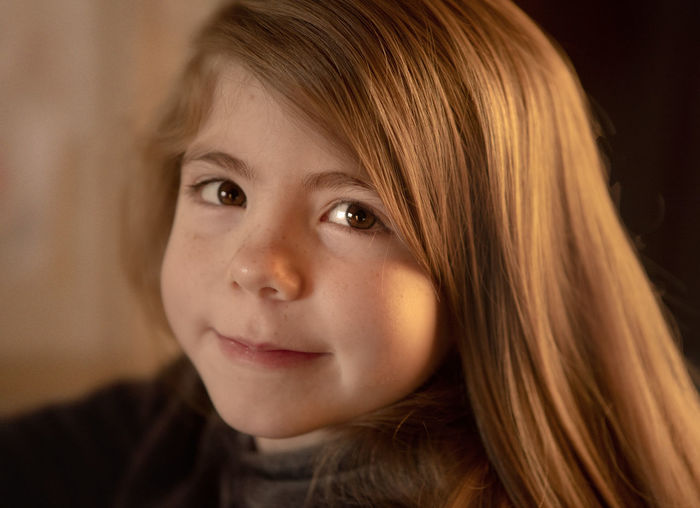 A portrait of a seven-year-old girl in the morning light. Portrait Headshot Child Childhood One Person Hair Looking At Camera Close-up Offspring Indoors  Blond Hair Body Part Hairstyle Innocence Girls Long Hair Brown Hair Front View Human Face Contemplation Bangs Morning Light Morning Smiling Golden Hour