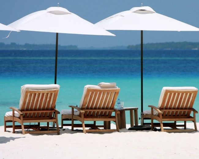 Absence Arrangement Beach Canonphotography Chair Check This Out Contemporary Dreaming Empty Enjoying Life Horizon Over Water In A Row Journey Leading Maldives Nowine Relaxation Sun Sunbeds And Umbrella Table Taking Photos Turquoise Vertical Symmetry Wineandmore Wood
