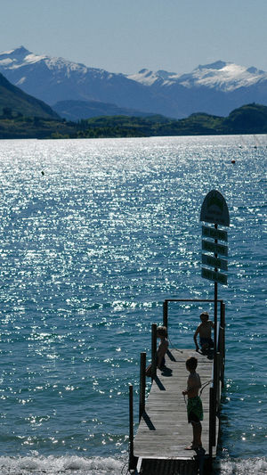 summer reflection in Lake Wanaka, New Zealand Beauty In Nature Day Fun Lake Lake View Lakeshore Mountain Mountain Range Nature One Person Outdoor Photography Outdoors People Real People Reflection Scenics Sky Sports Summer Tranquil Scene Tranquility Enjoy The New Normal