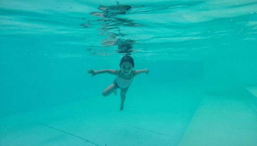 Swimming Swimming Pool Water Underwater Child Children Only One Girl Only People One Person Summer Girls Full Length Childhood Floating On Water Looking At Camera Human Body Part Portrait Day Happiness Outdoors