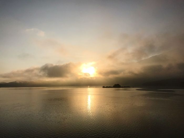 Water Sky Sea Sunset Scenics - Nature Cloud - Sky Tranquility Sun Sunlight Nature Beauty In Nature Reflection