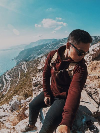 Sitting on the high rock of Dog's Head! As in french the Tête de Chien Gopro City EyeEm Best Shots Perspective France Adventure One Person Real People Leisure Activity Lifestyles Casual Clothing Sitting Beach Glasses Sea Nature Day Rock - Object Land Outdoors Young Adult