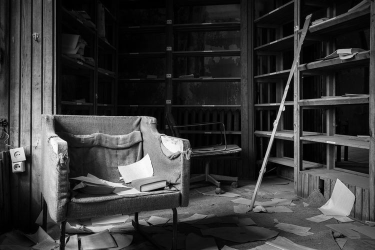 I'm not much of a reader Absence B&w Bad Condition Blackandwhite Chair Damaged Deterioration Dirty Empty Estonia Europe Furniture Interior Library Messy Monochrome No People Obsolete Old Patarei Prison Run-down Tallinn The Past Urbex