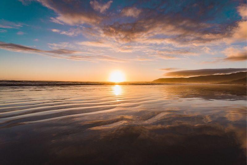 Home Sky Water Scenics - Nature Beauty In Nature Sunset Sea Cloud - Sky Sun Horizon Over Water Beach Idyllic Non-urban Scene Tranquil Scene Nature Tranquility Reflection No People Land Outdoors Horizon