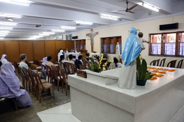 Pilgrims pray beside the tomb of Mother Teresa in Kolkata, West Bengal, India on February 07,2014. Missionaries Agnes ASIA Bojaxhiu Calcutta Catholic Charity Christianity Faith Gonxhe Humanitarian India Kolkata Mission Mother Mother House Nun Pilgrim Poor  Prize Religious  Sister Teresa Tomb West Bengal