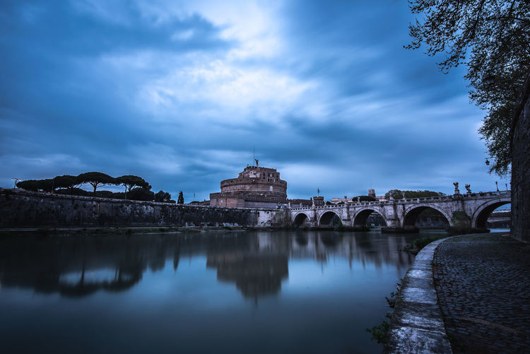 Italia Rome Italy Roma Rome Outdoors Dusk Sundown Sunset Long Exposure Copyspace Copy Space No People Travel Destinations Nature Bridge - Man Made Structure Waterfront Reflection Bridge River Connection Cloud - Sky Sky Water Building Exterior Architecture Built Structure Riverside Castle