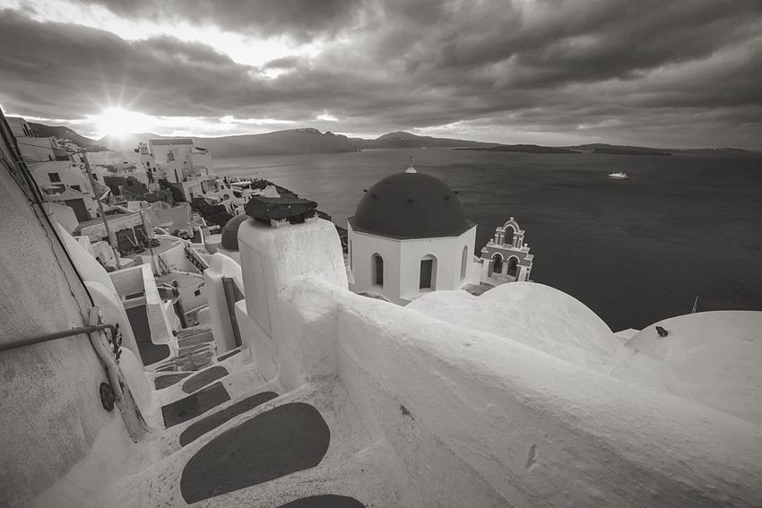 Mono Steps Architecture Built Structure Building Exterior Sky Mountain Spirituality Cloud - Sky High Angle View Outdoors Religion No People Nature Day Place Of Worship Sunlight Travel Destinations Winter Whitewashed Beauty In Nature Santorini Oia Santorini Greek Islands Greek Summer Greece Summer Go Higher