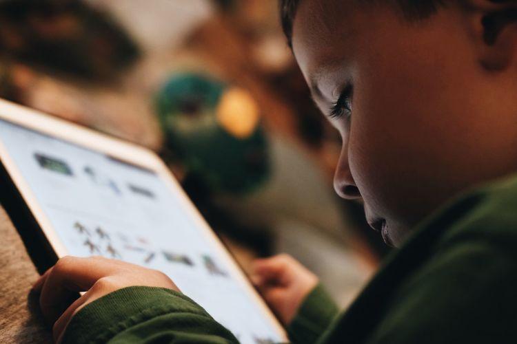 Boy looking at tablet screen