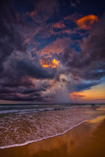 Storm over the ocean Colors Water Reflections Rain Storm Cloud Sea Water Sky Beauty In Nature Land Cloud - Sky Beach Scenics - Nature Horizon Horizon Over Water Nature Tranquility Sunset Tranquil Scene Dramatic Sky No People Idyllic Seascape Outdoors Power In Nature