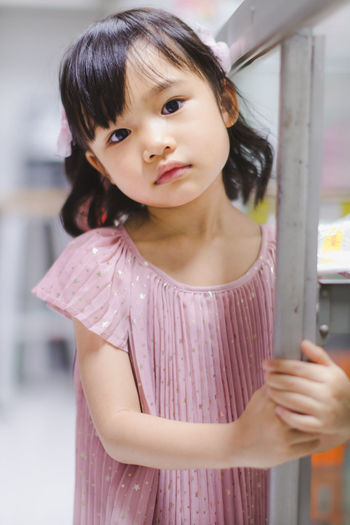 Childhood Child Girls One Person Standing Females Women Casual Clothing Waist Up Innocence Cute Real People Front View Portrait Looking At Camera Lifestyles Focus On Foreground Hairstyle Bangs