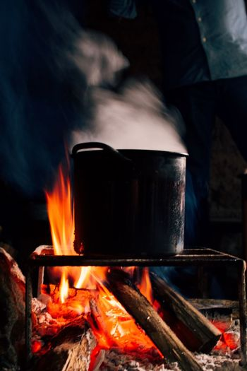 Close-up of food getting cooked on wood burning stove