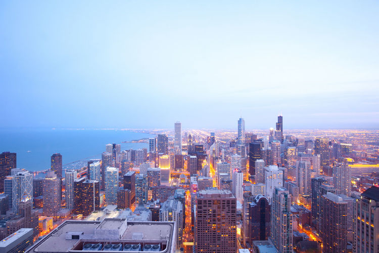 Aerial view of downtown Chicago, Illinois Chicago Downtown Illinois Skyline Aerial Architecture Building Exterior City City Life Cityscape Downtown District High Angle View Illuminated Modern Night No People Outdoors Skyscraper Travel Destinations Urban Skyline
