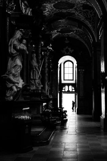 Staring at his phone instead of enjoying the surrounding culture - typical of today's culture? Arch Arched Architectural Column Architecture Built Structure Capture Culture Day Full Length History Person Place Of Worship Window Zerofotografie.nl Zerozomermissies2016