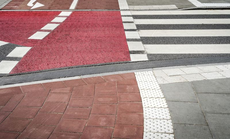Asphalt Backgrounds Bicycle Bike Rider Blinds Drivers Full Frame High Angle View Marking No People Outdoors Pedestrian Pedestrian Walkway Road Road Marking Road Markings Roads Street Street Photography Streetphotography Transportation Let's Go. Together. Your Ticket To Europe EyeEm Best Shots Getty Images