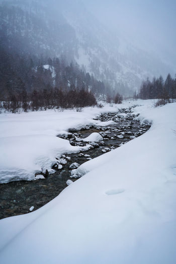 River in Switzerland during winter Winter Switzerland River Mountains Nature Roaming Outdoors Snow Mood Moody Sky Liveauthentic Suisse  Morteratsch Valley Morteratsch Travel Winter Time Cold Temperature