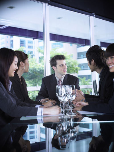 group of business people at restaurant Business Celebration Collaboration Discussion Food And Drink Full Suit Happiness Lunch Refreshment Teamwork Well-dressed Wine Glass Business Plan Businessman Businesswomen Colleague Formalwear Group Of People Hotel Lunch Meeting Occupation Restaurant Success Wine Wineglass