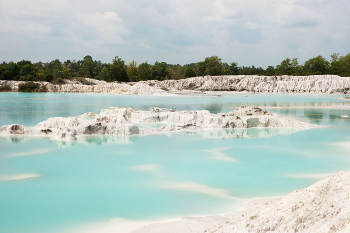 Man-made artificial lake Kaolin, turned from a mining ground holes. Land contains kaolinite and is white. Due to mining, holes were formed. and were covered by rain water, forming a clear blue lake, Air Raya Village, Tanjung Pandan, Belitung Island. Beauty In Nature Belitung Island Belitung, Indonesia Blue Bright Water Clear Water Clear Waters Day Island Kaolin Kaolin Lake Kaolinite Lake Landscape Nature No People Outdoors Scenics Tranquility Travel Travel Destinations Water White Color